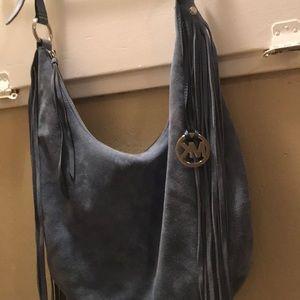 Fringe over the shoulder purse